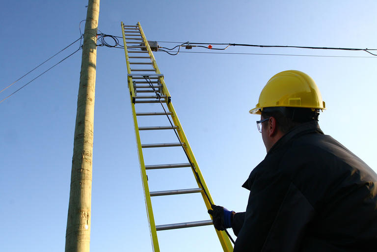Technician with a ladder